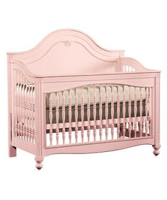 Cotton candy pink crib, our crib is much more plain but this is the color I'm going for.