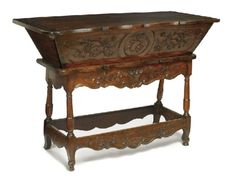 A FRENCH PROVINCIAL CARVED FRUITWOOD DOUGH BIN, CIRCA 1820