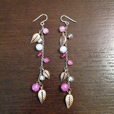 """American Eagle Leaf and Bead Dangle Earrings Approx. 2.75"""" drop dangle earrings. Brass tone leaves and pink beads on a silver tone chain. American Eagle Outfitters Jewelry Earrings"""