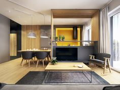 Designed by the Polish creative agency PLASTERLINA, this Warsaw apartment takes an innovative approach to the ever-popular Scandinavian style. The open plan liv Ideas For Kitchens, Black Kitchens, Kitchen Design, Design Kitchen, Apartments, Modern Kitchens Cuisine noire et touches de jaune, éclairage leds | black Kitchen with pops of Yellow, light A Modern Scandinavian Inspired …