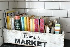 s organize your kitchen with these 16 simple and cheap storage ideas, kitchen design, organizing, storage ideas, Grab an old wood box for your cookbooks Cheap Storage, Fridge Decor, Old Wooden Boxes, Old Wood, Kitchen Decor, Cookbook Storage, Cookbook Display, Wood Boxes, Vintage Home Decor