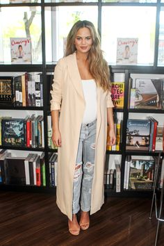 CHRISSY TEIGEN Maternity style or not, a tank, floor-length duster jacket and ripped boyfriend jeans is a fail-proof combo.