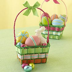 Easter basket idea repurposing plastic pint-size strawberry cartons (at supermarkets and produce stands). I'm trying to think of an easier way to make the handle instead of using a coat hanger...bet you can think of something!