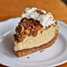 Toffee crust smeared with a layer of milk chocolate under a creamy caramel cheesecake with crunchy toffee, caramel, and whipped cream on top