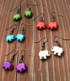 20% off all items in Erin's Etsy shop. Use Coupon code CAMP20  Elephant Dangle Earrings Hippie Kid Fashion by PazHappyCreations