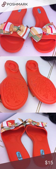Fun orange beach shoes Adorable rubber type shoes. Big bow on toes that can be removed. Gently worn  no obvious flaws. Okab Shoes