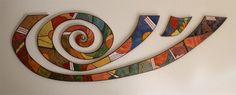 Wall-forming Spiral, silk screen enamel on copper by Ingeborg Martin.