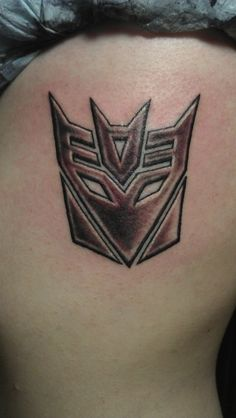 my decepticon tattoo on my left ribs! Done by Maxwell Mogstad at Eighth Element Tattoo in Fountain Valley CA
