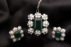 Diamond and emerald pendant earrings