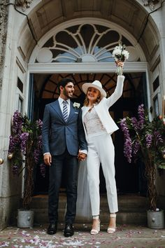 Bride in a white trouser suit paired with a lace top and white, ankle-strap sandals along with a wedding fedora adorned with a tulle veil. Wedding Dress Suit, Bride Suit, Civil Wedding Dresses, Womens Wedding Suits, City Hall Wedding, London Wedding, Wedding Reception, Bridal Hat, Bridal Gowns