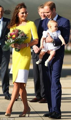 Warm welcome: Kate clutched a bunch of native Australian flowers, meanwhile William held baby George in his arms as they made their way across the tarmac #katemiddleton #princegeorge