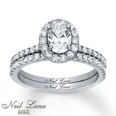 Exquisitely balanced, an impressive 1 carat oval diamond encircled in round diamonds crests above a band lined with additional round diamonds in this lovely engagement ring from the Neil Lane Bridal® collection. Delicate milgrain detail traces the profile while the matching wedding band features a row of round diamonds to complement. Styled in 14K white gold, the rings have a total diamond weight of 1 3/4 carats. Each Neil Lane Bridal® ring is hand-crafted and undergoes a four-step process…