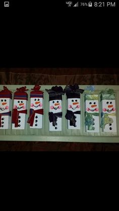 2x4s decorated to look like snowman