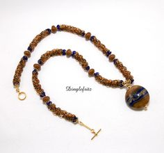 Caramel brown and blue beaded necklace by Sue Clark Koenig - Dinglefritz