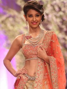 Winner of Femina Miss India World '13 Navneet kaur Dhillon walks the ramp for designer Jyotsna Tiwari during India Bridal Fashion Week '13