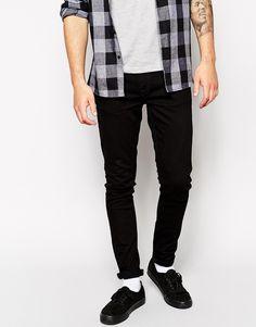 €145, Schwarze Enge Jeans von Nudie Jeans. Online-Shop: Asos. Klicken Sie hier für mehr Informationen: https://lookastic.com/men/shop_items/302603/redirect