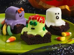Spooky Brownies*Brownies topped w/ Marshmallows covered in candy melts & decorated.