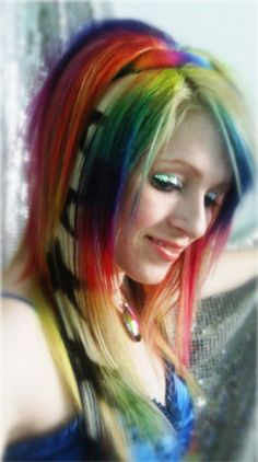 This is a combination of manic panic (hot hot pink, electric banana), special effects (napalm orange), pravana (blue, purple), and joico (green). and blonde, of course, by Joico. The black stars were stenciled onto a blonde extension with Redken Shades 01, Onyx.