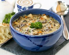 This Chicken Wild Rice Soup is a hearty creamy soup made with cooked chicken, nutty wild rice, and mushrooms. It is a bowl of comfort any time of the year.   Food to gladden the heart at RotiNRice.com