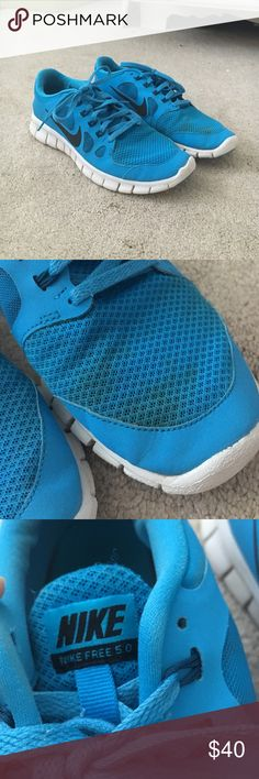 Nike free run 5.0 electric blue Good condition except the mud stain on the left shoe (shown in listing) other than that not much sign of wear!! Don't pass these up! Nike Shoes Athletic Shoes