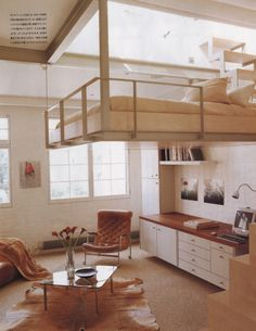 Jo Rippon Architecture/ Retrouvius Design. Suspended bed, maple staircase, original steelwork colours
