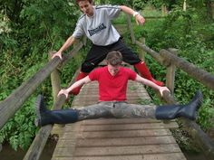 Booted brothers on a bridge.