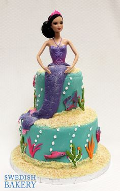 Barbie Mermaid | Two tier, buttercream children's party cake with sugar layon sea creatures and doll top with fondant mermaid tail.