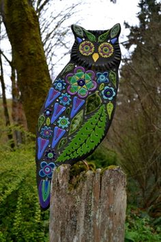 Mosaic • Clare Dohna uses leaf and flower motifs as well as a natural color palette so that her pieces, like this owl, seem right at home in garden settings.