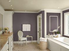 Benjamin Moore Paint Colors - Purple Bathroom Ideas - Deep, Dramatic Purple Bathroom - Paint Color Schemes . . . . . Warm purple gives this bath a surprisingly cozy atmosphere. . . . . . Walls - Amazon Soil (2115-30); Trim (trim & cabinets) - Mountain Peak White (OC-121); Ceiling - Frappe (AF-85).