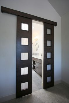 Split barn doors. Love this idea instead of using a regular door.