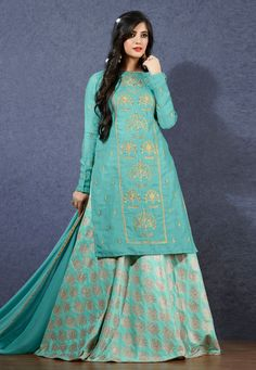Breathtaking sea blue linen lehenga style suit online which is crafted from linen fabric with exclusive embroidery and hand work. This stunning designer lehenga style suit comes with silk bottom and nylon chiffon dupatta. Kurta Skirt, Kurta Lehenga, Long Choli Lehenga, Green Lehenga, Ghagra Choli, Kurti, Choli Designs, Lehenga Designs, Latest Anarkali Suits