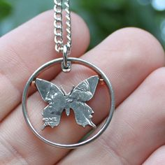 Butterfly open quarter cut coin necklace - what a neat idea, and well executed!