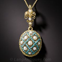 Reminiscent of a Faberge egg, this ultra-lovely pendant dates back to the latter-nineteenth century and is beautifully ornamented with a turquoise studded criss-cross design centered with 9 lustrous button pearls with a twisted rope border. A fleur-de-lis bail adds a certain je ne sais quoi. 15K gold, thus most likely of British origin (despite the Frenchy design). Just over 1 3/4 inch.