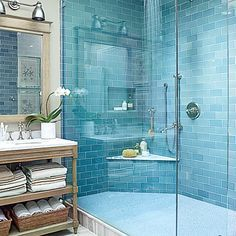 Beachy blue, glazed subway tile (from Waterworks) are the main event in this Rehoboth Beach, Delaware bath. A smart cutout and bench add a practical slant to the pretty shower.