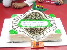Homemade Roller Coaster Birthday Cake: My daughter's 5th birthday party was at a local amusement park and she wanted a Roller Coaster Birthday Cake.  Specifically, she wanted a 3-D dragon coaster