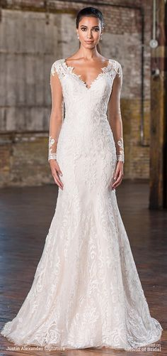 Lace appliques draw the eye to the illusion long sleeves and V-neckline of this tulle fit and flare gown with point d'esprit underlay and a chapel length train. | Justin Alexander Signature Fall 2016 Wedding Dresses via @WorldofBridal