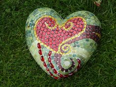 i can't tell if this is mosaic on rock or hand-painted to look like a mosaic- but either can be done