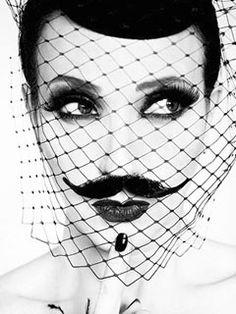 As Morticia Addams: Bebe Neuwirth. Photo: Ruven Afanador. Hat by Pier Atkinson)