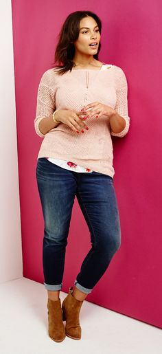 Layer an open-knitted sweater over a printed tank for a peek of color (and added warmth!). Slip into your fave pair of denim and roll 'em up to show off those ankle booties. Say hi to another 9-to-5 approved outfit.
