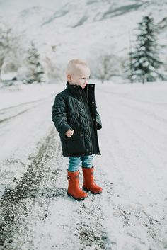 This little boy in his snow clothes is the cutest! I love that quilted jacket and his red rain boots.