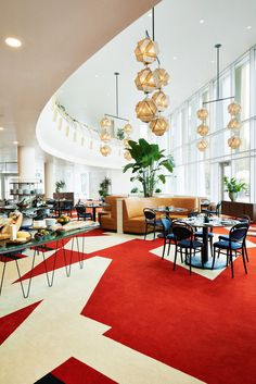 Commune Design have transformed an old bank into a mid-century modern hotel in the heart of downtown Durham, inspired by the spirit of its namesake city.