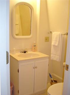 Bathroom with sink, toilet, and shower Corner Bathtub, Toilet, Sink, Shower, Bathroom, Sink Tops, Rain Shower Heads, Washroom, Flush Toilet