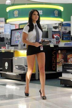 Olivia Munn gorgeous legs in a short black skirt and high heels