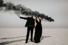elegant smoke bomb photoshoot with contrast wearing a black dress // Salt Plains National Wildlife Refuge near Jet, Oklahoma // surprise engagement proposal