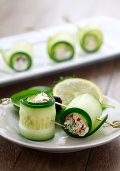 Cucumber, feta, Greek yogurt, kalamata olives, sun dried tomatoes and fill and rolled up into a pretty little appetizer bite! Yum