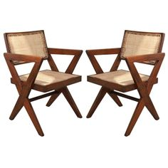 1stdibs.com | Pair of Pierre Jeanneret Armchairs