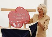 Camilla Duchess of Cornwall unveils a plaque as she visits the Poppy Pod Village at the Tile Barn Outdoor Centre on July 26 2016 in Brokenhurst...