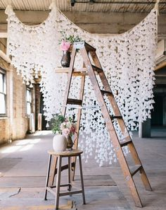 Shape doilies into little cones and string from a rope for a beautiful photography backdrop or wedding decoration.