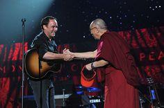 Dave Matthews Photos Photos - Dave Matthews and His Holiness the Dalai Lama shake hands onstage at the One World Concert at Syracuse University on October 9, 2012 in Syracuse, New York. - One World Concert At Syracuse University