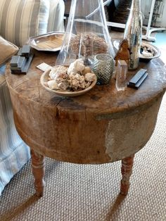 LOVE how this old butcher block is being used as a side table!